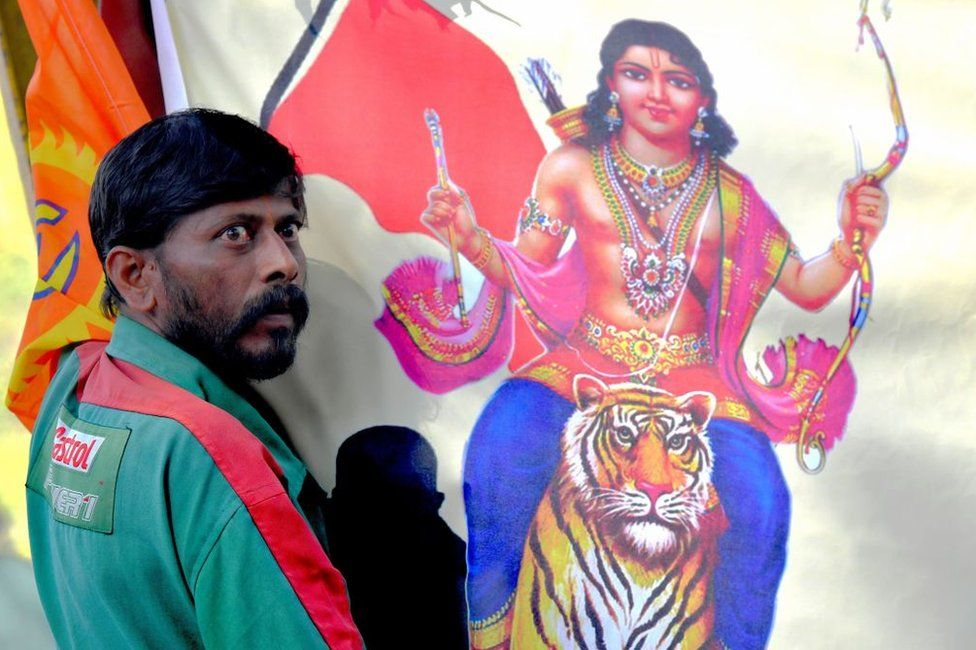 An Indian Hindu devotee of the Lord Ayyappa looks on at a protest in Kerala.