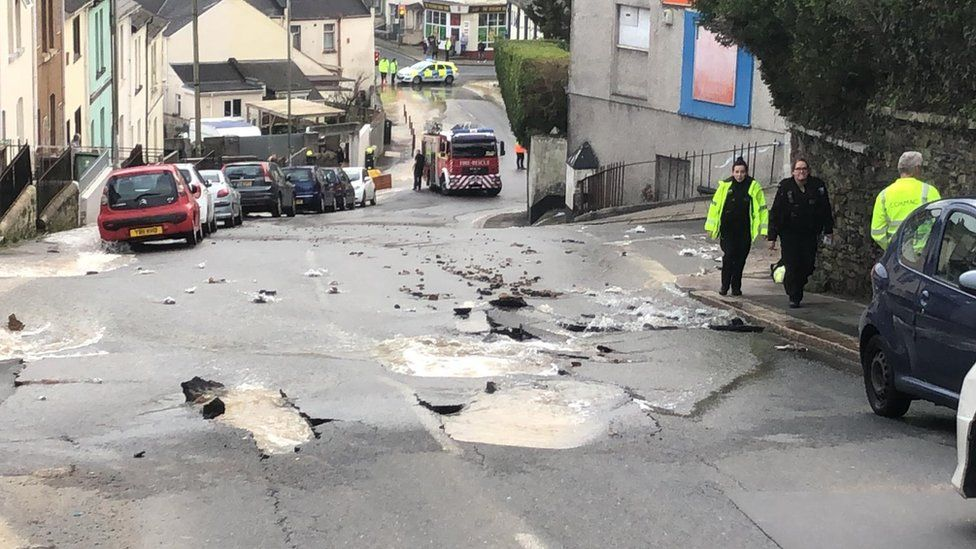 A burst water main in a street