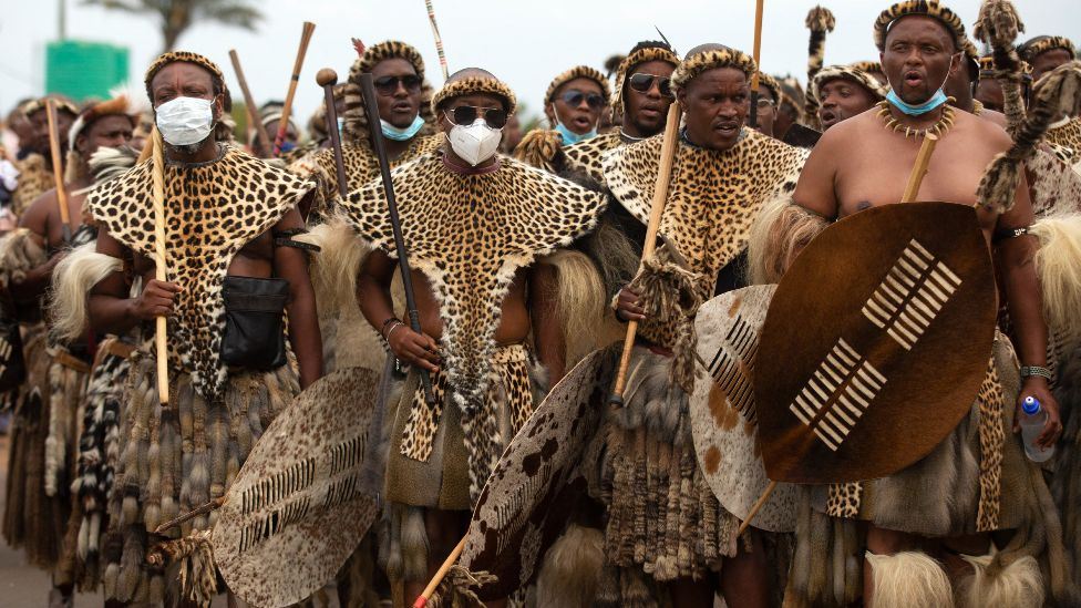 Zulu men in traditional warrior outfits with shields in Nongoma, South Africa - 17 March 2021