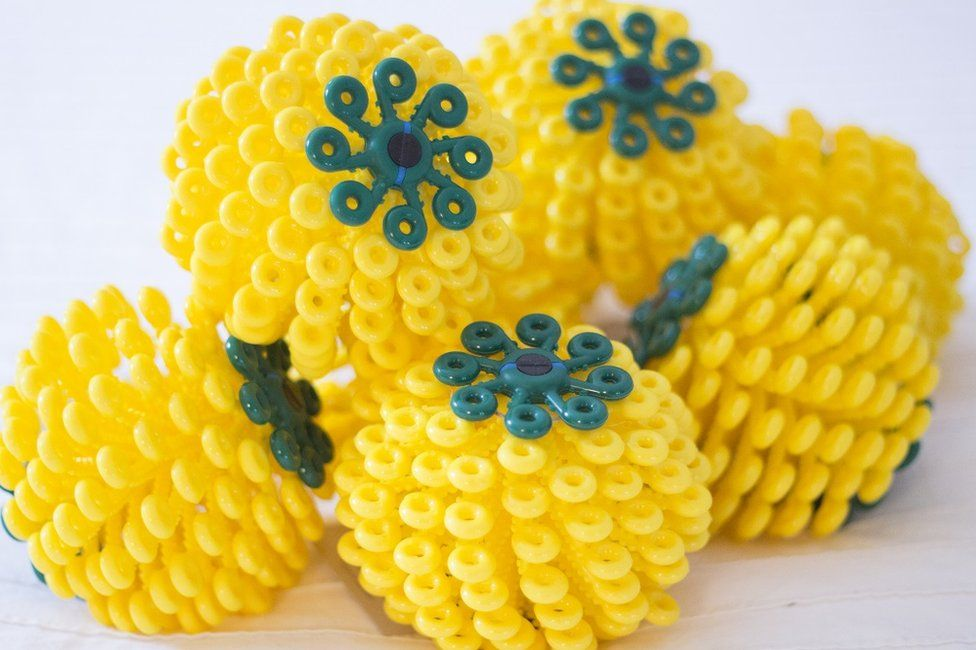 Yellow Cora Balls in a pile
