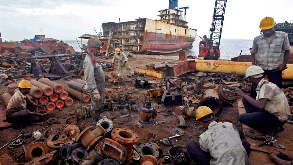 Workers dismantle a decommissioned ship at the Alang shipyard, 2007