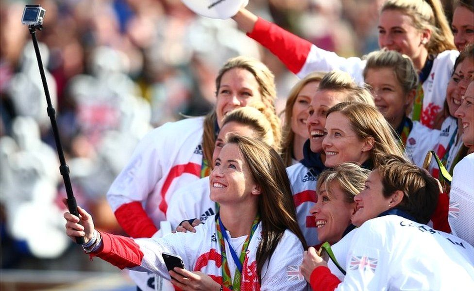 Womens hockey player, Maddie Hinch takes a group selfie