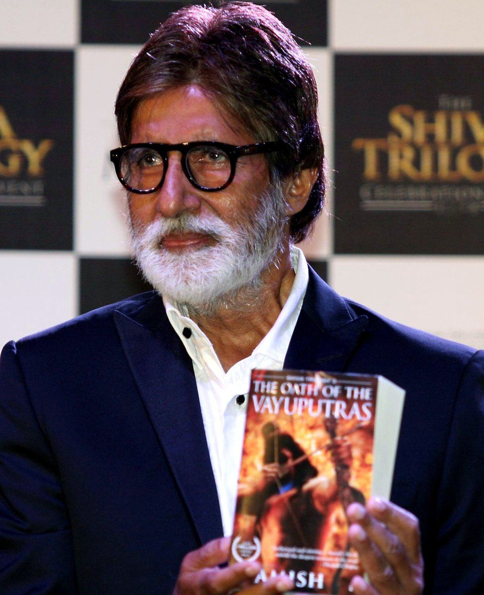 Bollywood superstar Amitabh Bachchan with a copy of one of Amish Tripathi's books