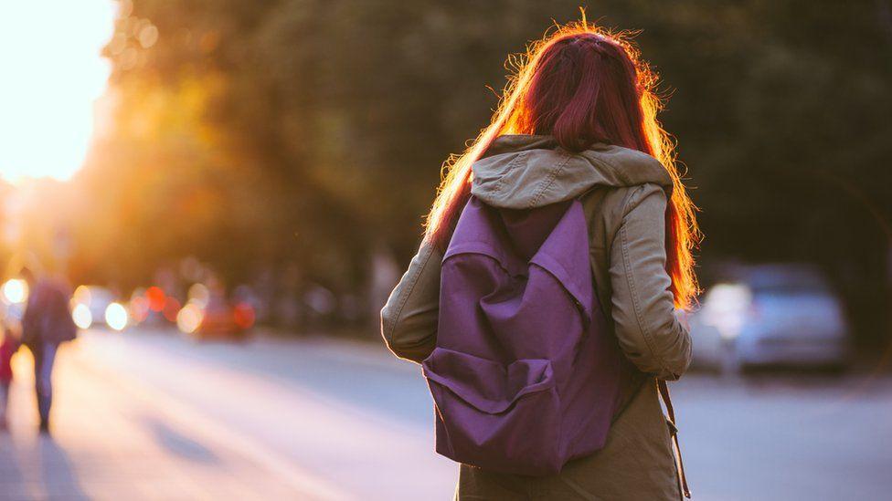 Teenager wearing school bag
