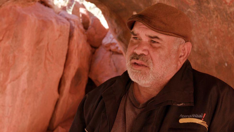 Sammy Wilson in a cave at Uluru