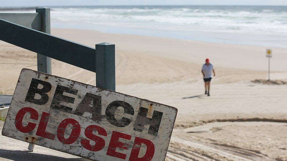"""Sign reads """"beach closed after fatal shark attack"""""""