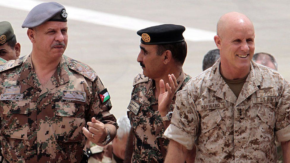 Jordan's Prince Faisal (L), Army's head of operations and training Major General Awni Adwan (C) and deputy commander of US Central Command, US Navy Vice Admiral Robert S. Harward (R) attend the 'Eager Lion' joint military exercise at the King Abdullah Special Operations Training Centre in Amman in 2012