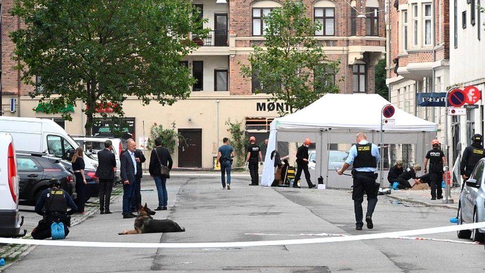 Danish police technicians inspect the scene outside a local police station, following an explosion in Copenhagen, Denmark August 10, 2019
