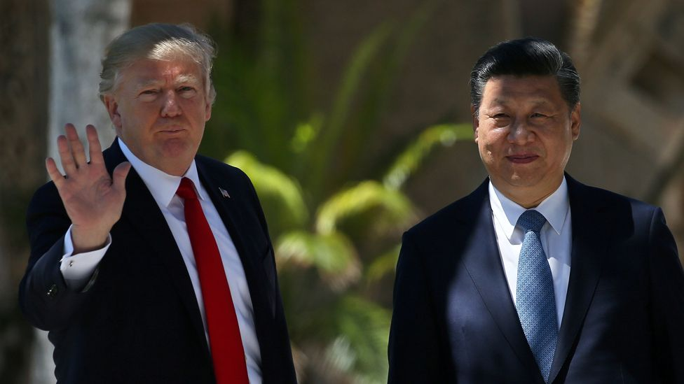 """U.S. President Donald Trump waves as he and China""""s President Xi Jinping walk along the front patio of the Mar-a-Lago estate after a bilateral meeting in Palm Beach, Florida, U.S., April 7, 2017"""