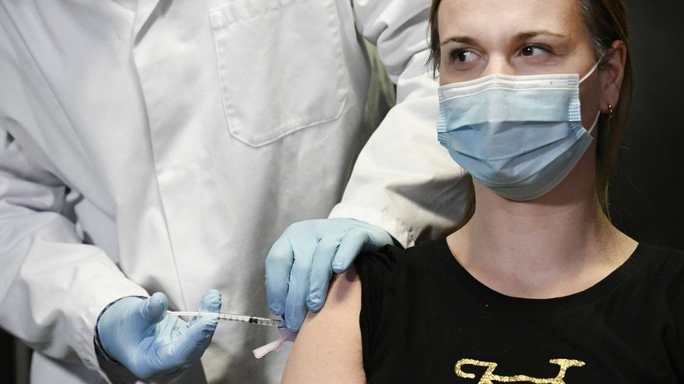 A doctor in the Netherlands receives the Moderna vaccination