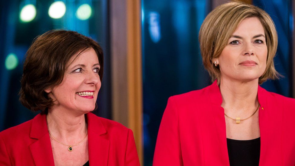 Rhineland-Palatinate state premier Malu Dreyer (L) looks at her challenger, Christian Democratic Union (CDU) party candidate Julia Kloeckner (R), during a TV interview (13 March)