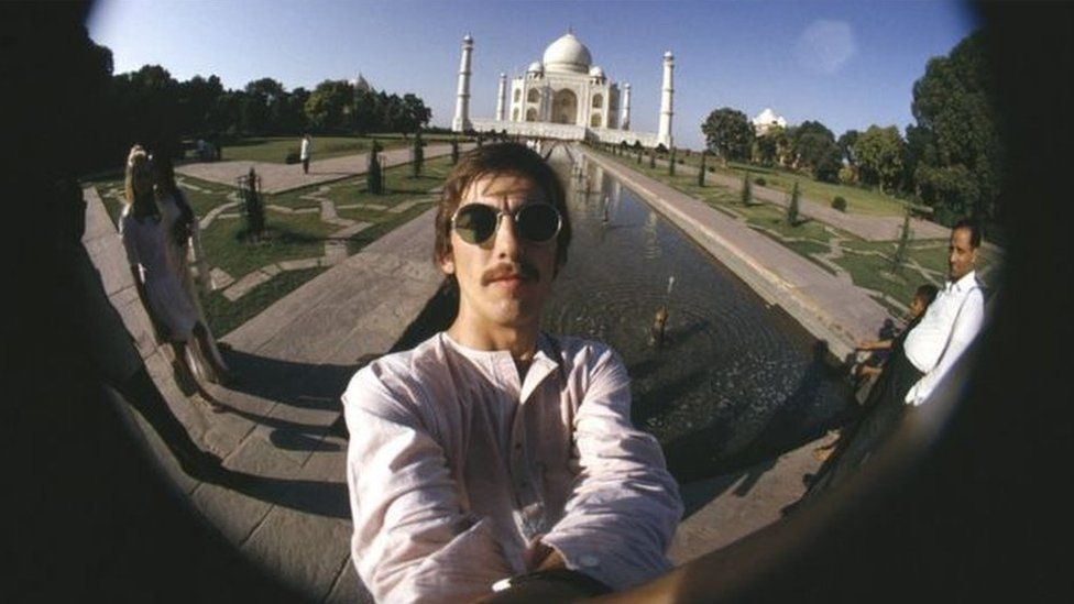 The Beatles lead-guitarist George Harrison takes a selfie in front of the Taj Mahal during his visit to India in 1966