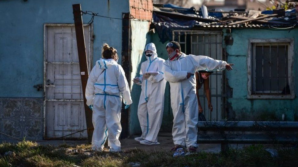 Employees of the Ministry of Health wearing PPE carry out tests of Covid-19 to residents at Villa Itati