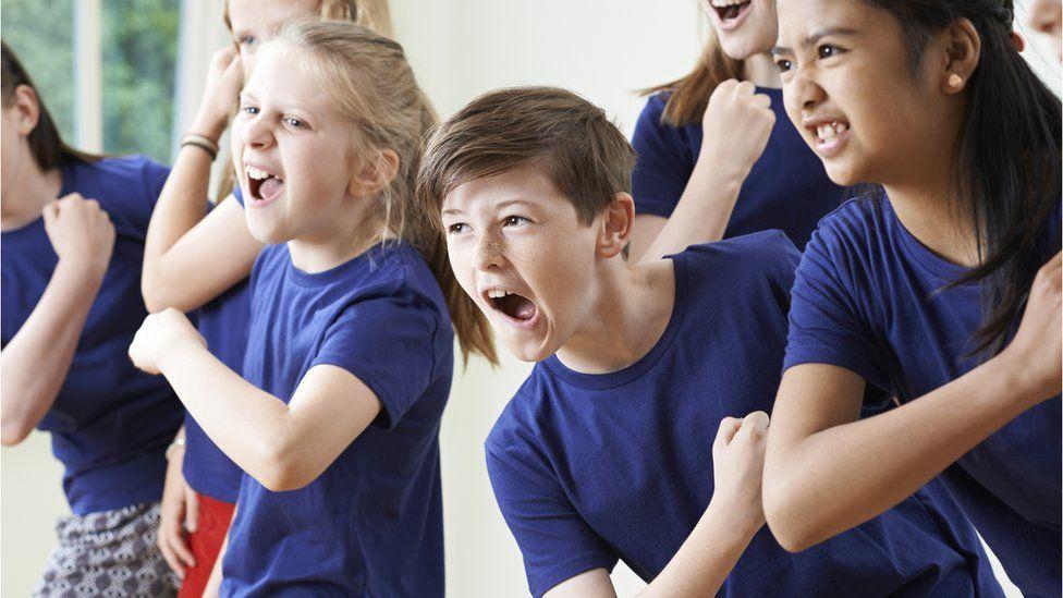 children enjoying drama class