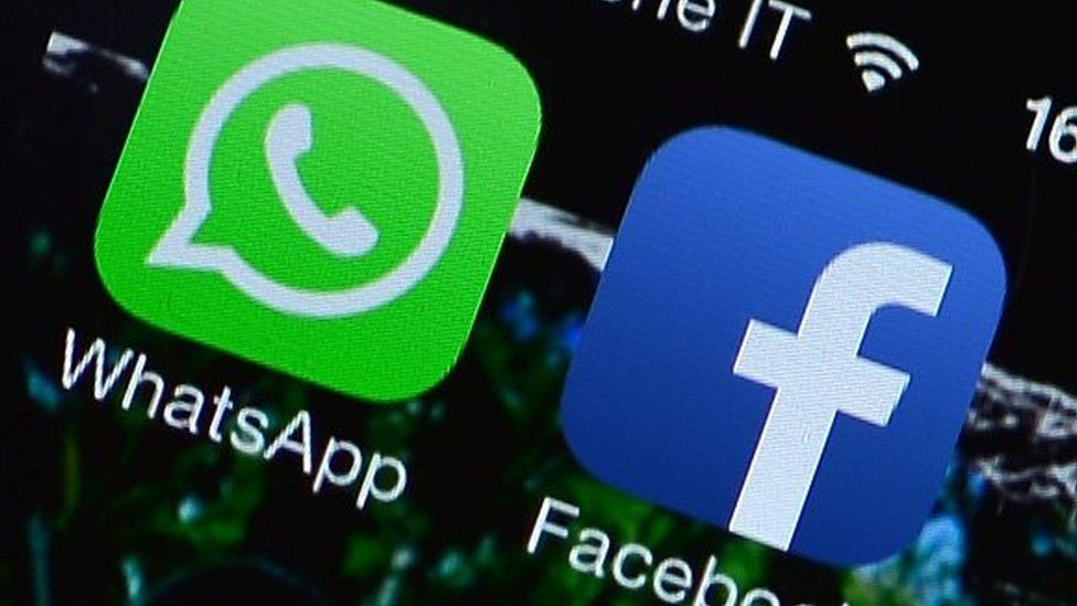 The Facebook and WhatsApp applications' icons are displayed on a smartphone on February 20, 2014 in Rome.