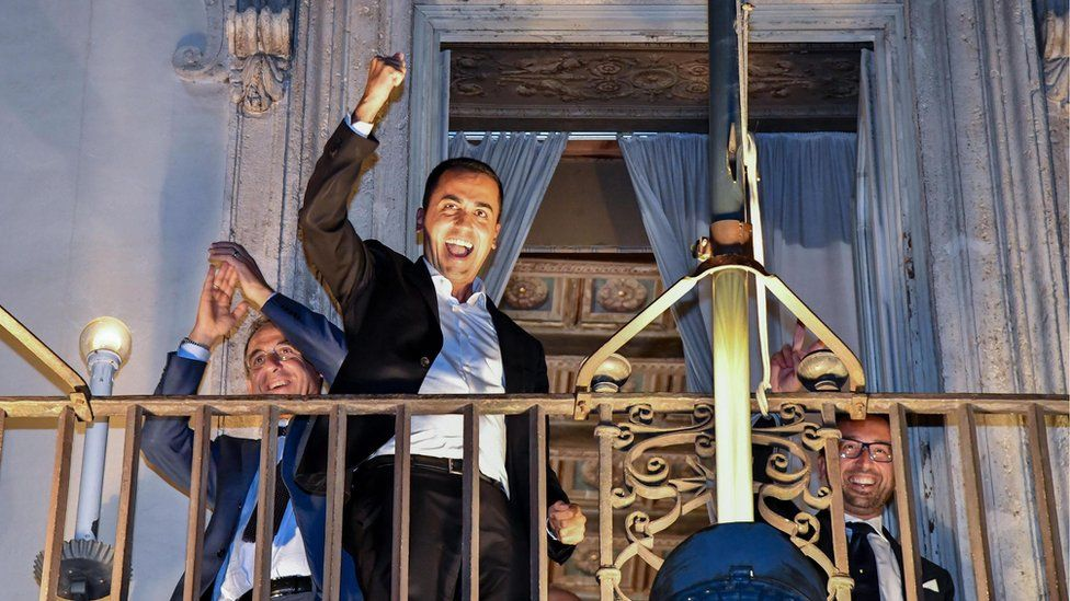 Italian Deputy Prime Minister Luigi Di Maio celebrates on a balcony of Chigi Palace on 27 September