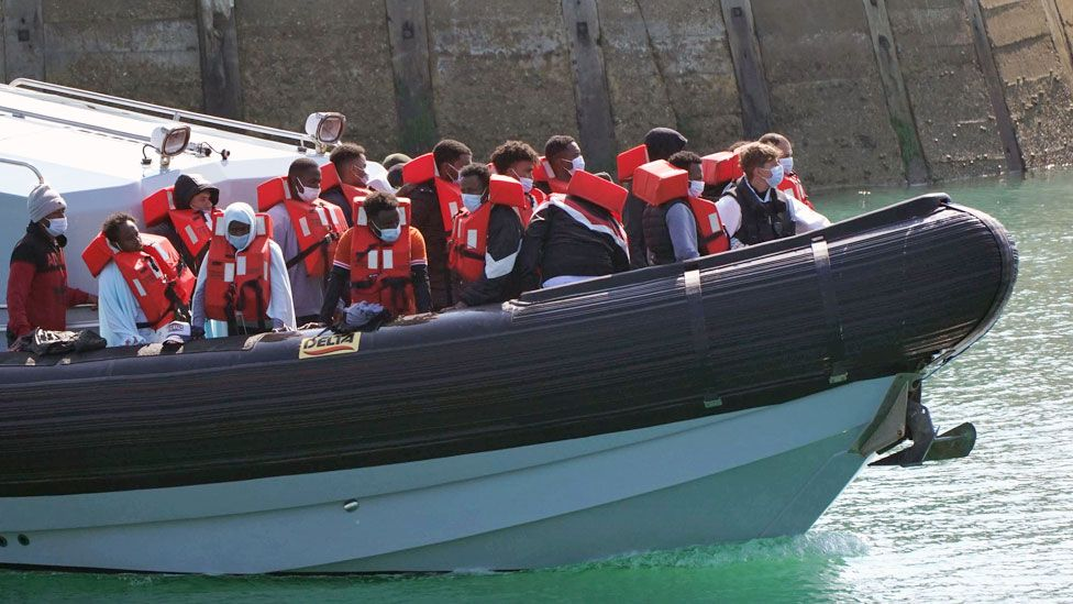 A group of people are brought in to Dover, Kent, by Border Force officers following a small boat incident in the Channel