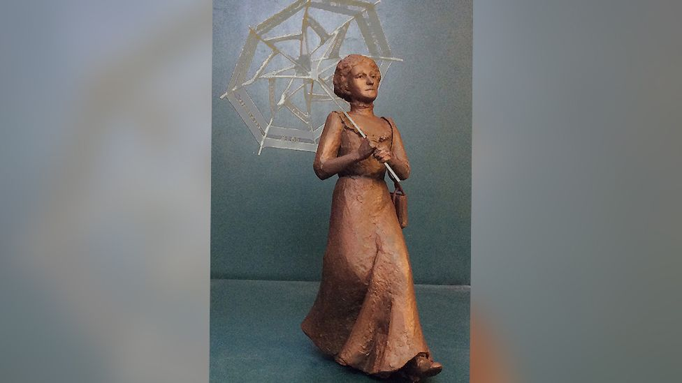 A maquette statue of Amy Walmsley