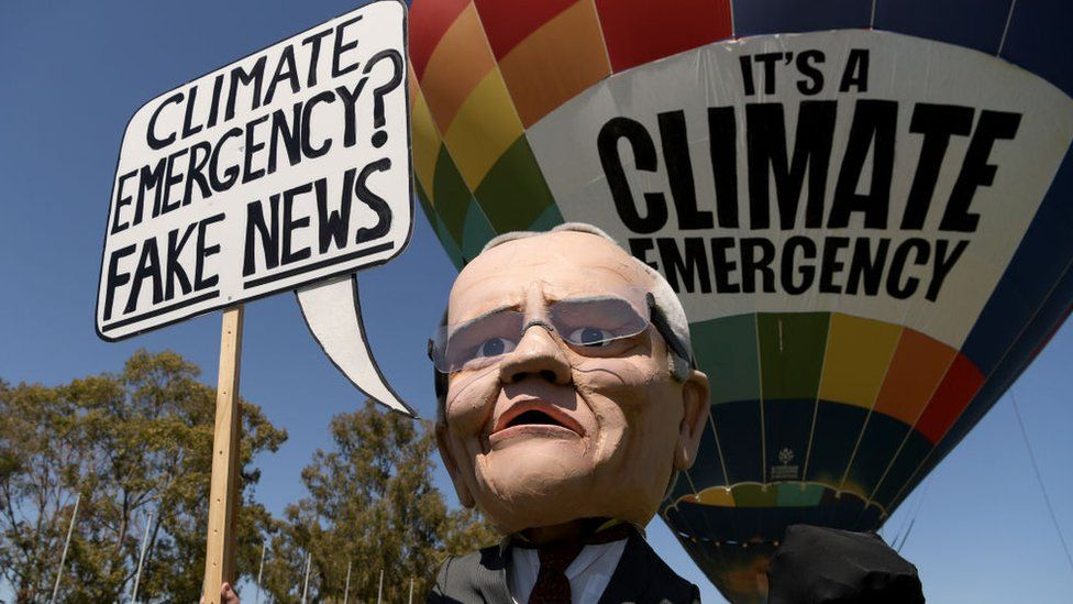 """A puppet of Australian PM Scott Morrison suggesting he thinks a climate emergency is """"fake news"""""""