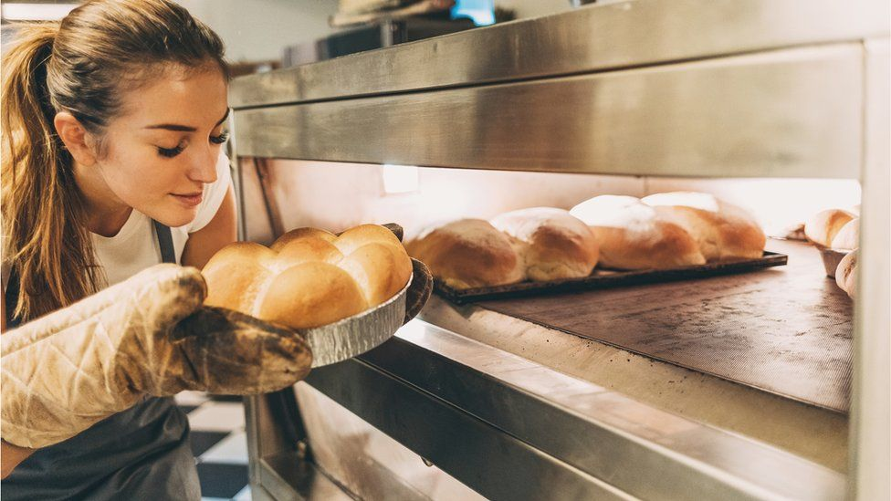 Woman smelling bread