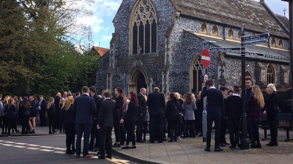 Mourners outside St John the Baptist church