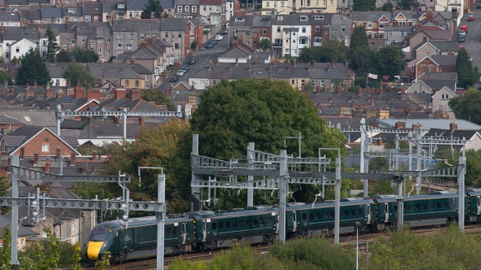 A First Great Western train near a residential area in Newport