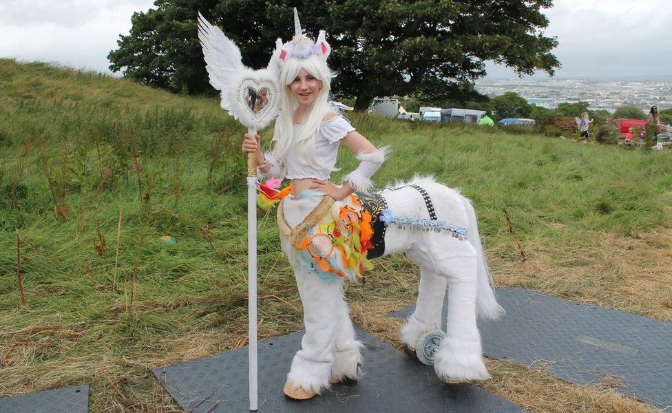 Ella Hill, dressed as a unicorn with wand
