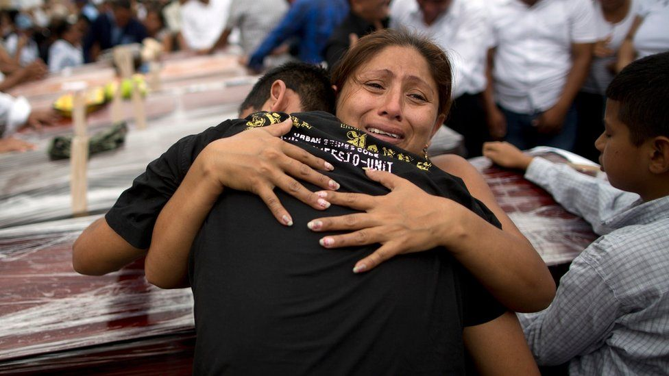 Relatives mourn the loss of their family members, victims of the 7.8-magnitude earthquake, during a funeral service in Portoviejo, Ecuador, Monday, April 18, 2016