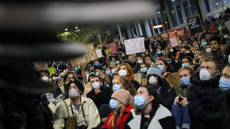 Crowd at a Black Lives Matter protest in Sydney wearing face masks