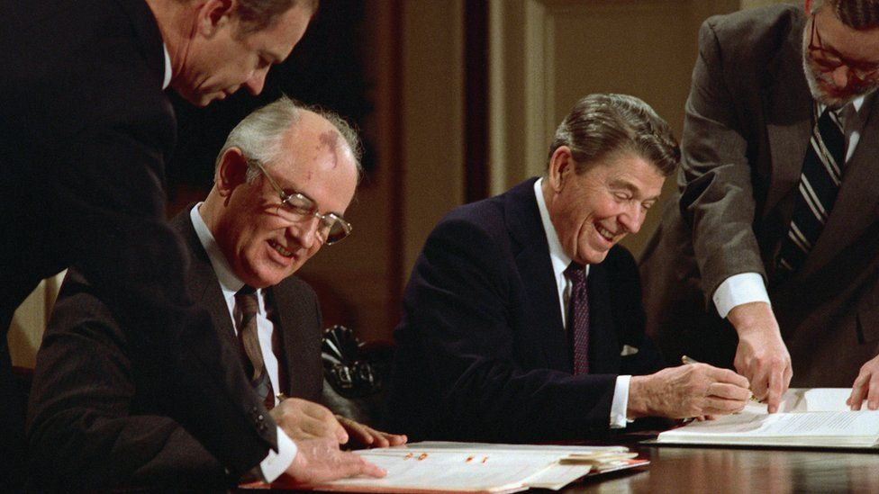 President Ronald Reagan and Soviet General Secretary Mikhail Gorbachev signing the arms control agreement banning the use of intermediate-range nuclear missiles