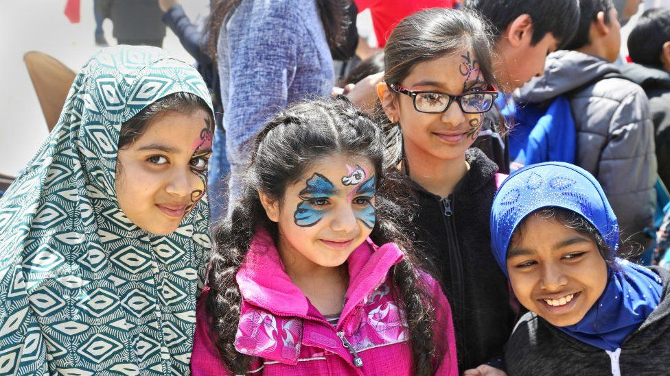 Children at an event celebrating immigration to Canada