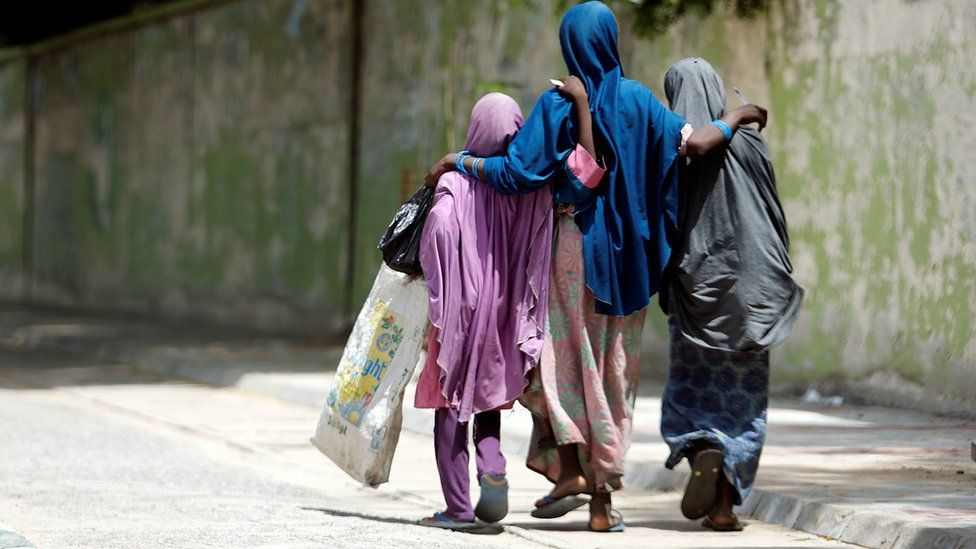 Girls walk along a street in Maiduguri, Nigeria - 30 August 2016