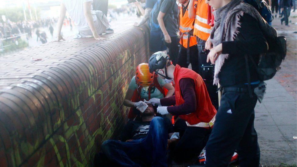 Medics help an injured person