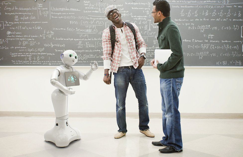 Pepper robot talking to two laughing men