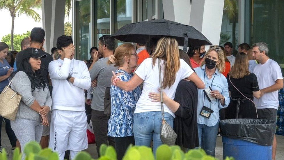 Families and friends of people that could have been at the partial collapse of the building in Surfside are waiting for information at the Surfside Community Center in Surfside, Florida, on 24 June 2021