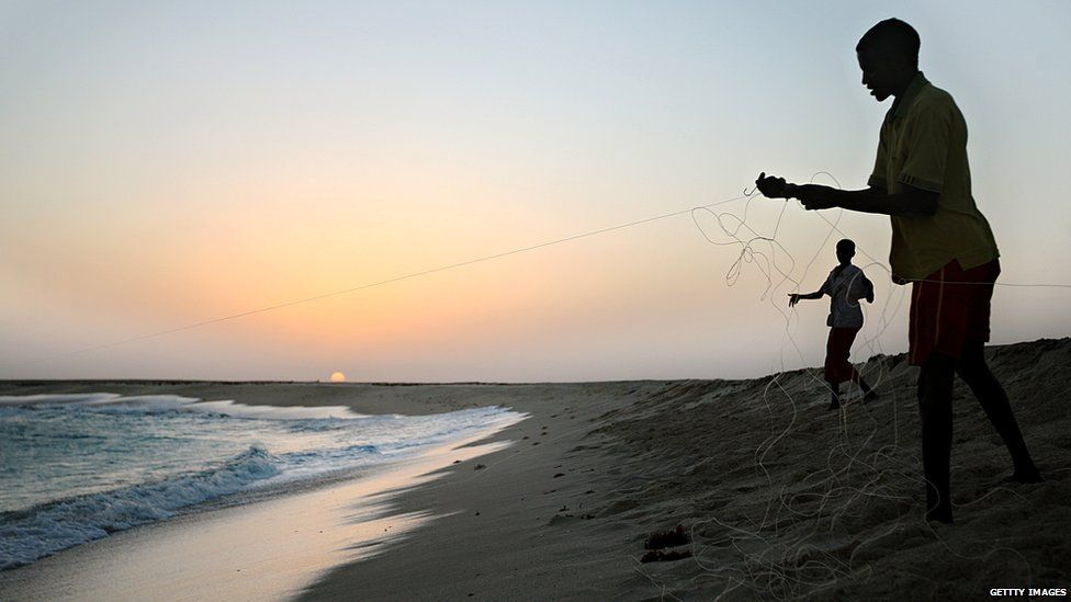 January 4, 2010 shows young Somali boys drawing their fishing lines at the coastal town of Hobyo in northeastern Somalia