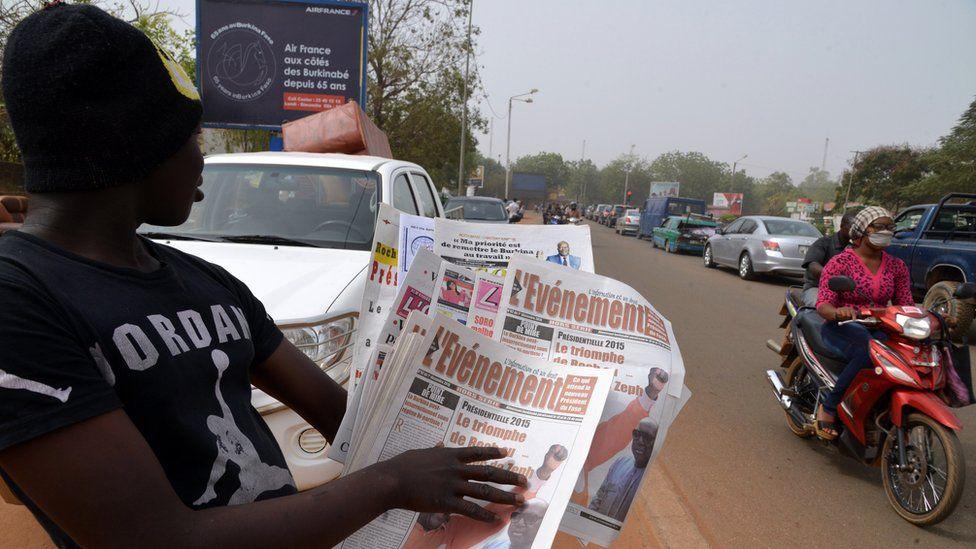 Newspaper vendor in Burkina Faso