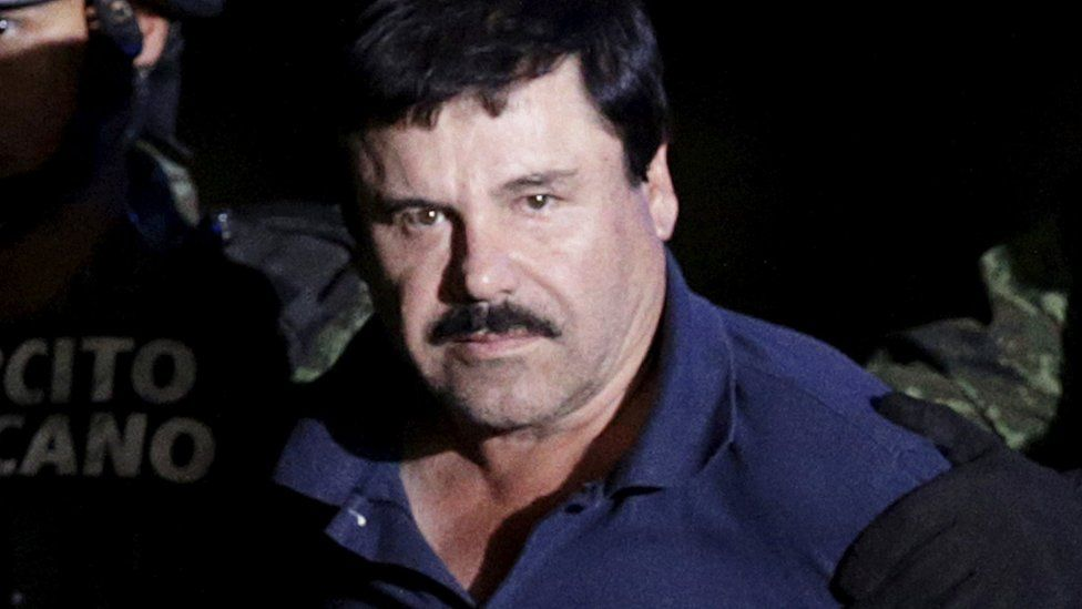 """Cartel boss Joaquin """"El Chapo"""" is escorted by soldiers"""