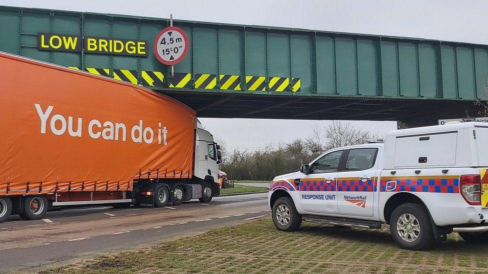 Lorry stuck under a bridge