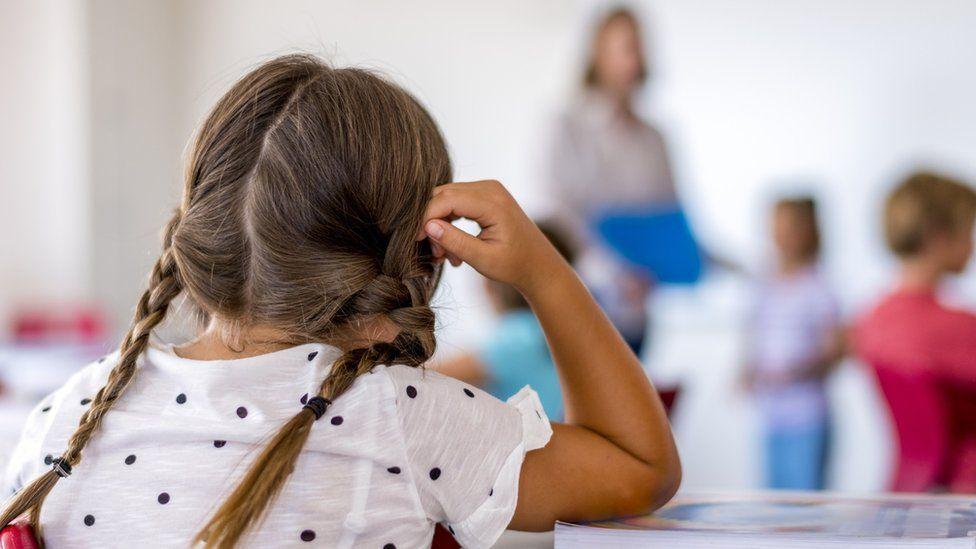 Schoolgirl in classroom