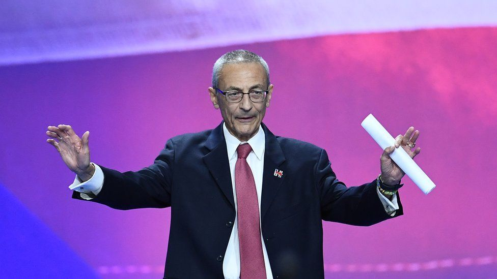 Democratic presidential nominee Hillary Clinton's campaign manger John Podesta gestures before speaking during election night at the Jacob K. Javits Convention Center in New York on November 9, 2016