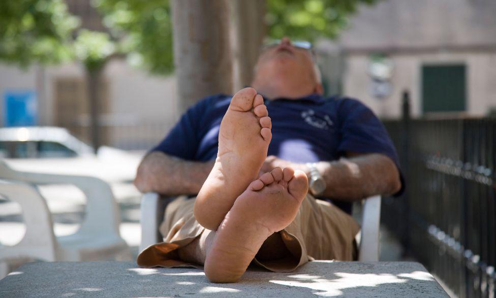 Siesta in Sa Pobla Plaza, Sa Pobla, Mallorca, Spain