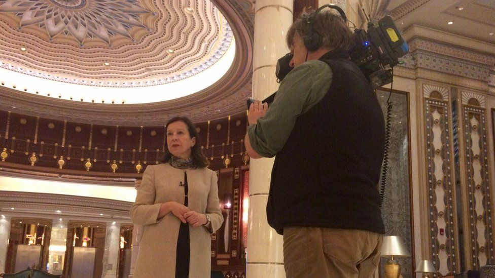 Lyse Doucet and Philip Goodwin record a piece to camera in the glitzy Ritz Carlton lobby in Riyadh.