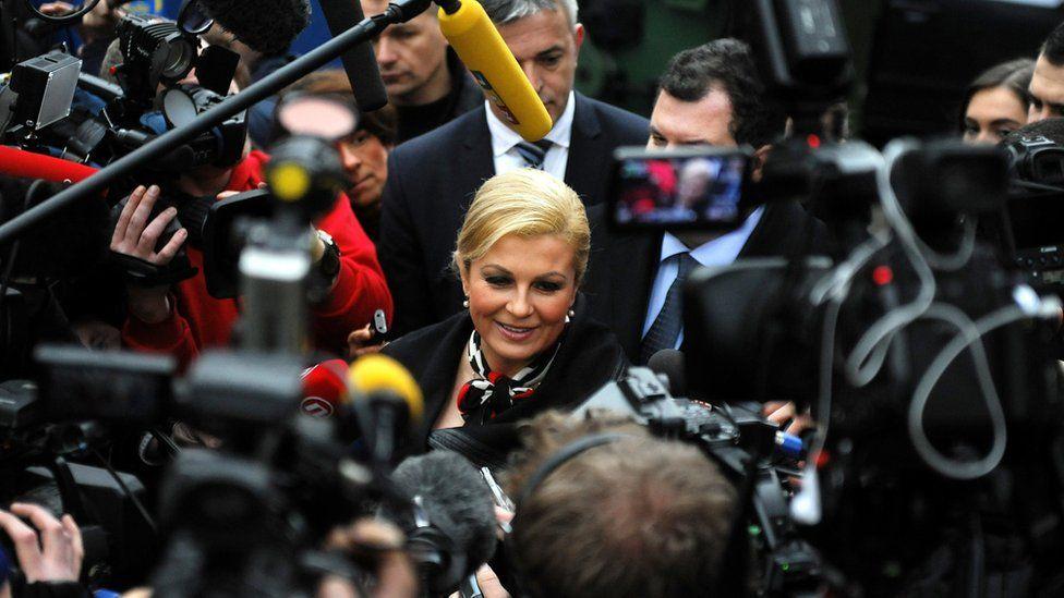 Reporters surround Croatia's president Kolinda Grabar-Kitarovic