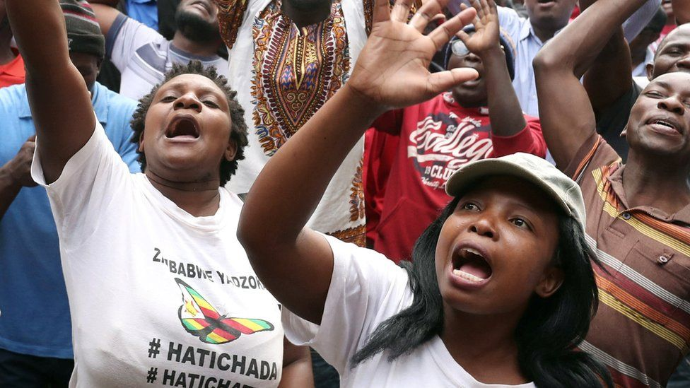 Opposition MDC supporters sing outside party headquarters following the Zimbabwe election, 31 July 2018