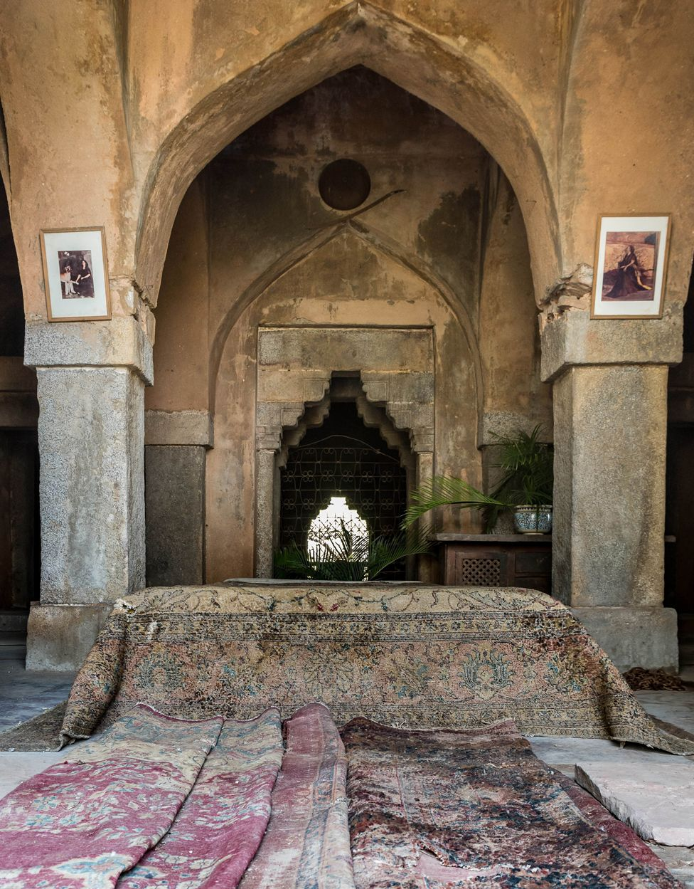 Carpets near a series of stone arches