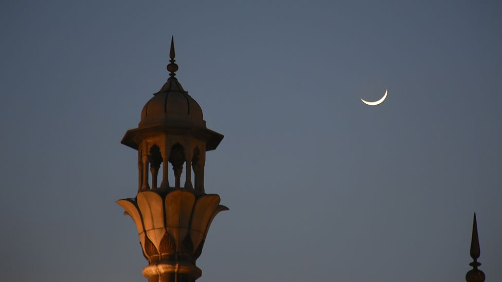 Crescent moon seen over the closed Grand Mosque of Delhi Jama Masjid on the first day of Ramadan on 25 April 2020.