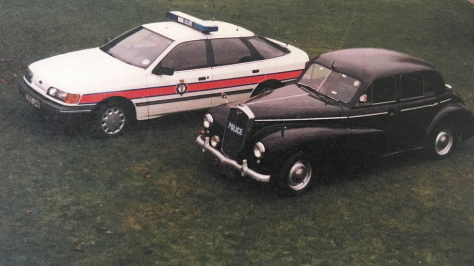 The 1951 Wolseley next to a 1980s police car
