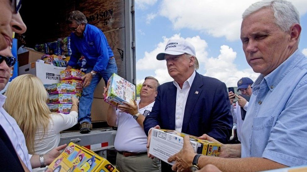 Trump and his vice presidential pick, Mike Pence, unloading goods for flood victims in Louisiana