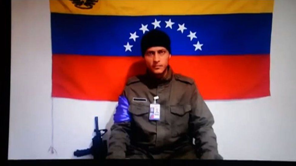 This file photo taken on July 4, 2017 shows a screenshot taken from a handout video released by Anonymous Venezuela late on July 4, 2017 showing the Venezuelan helicopter pilot who vanished after allegedly dropping grenades on the Supreme Court